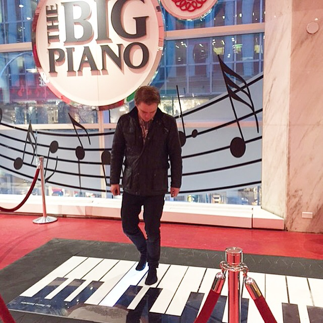 Me on that big piano in that big toy shop in New York