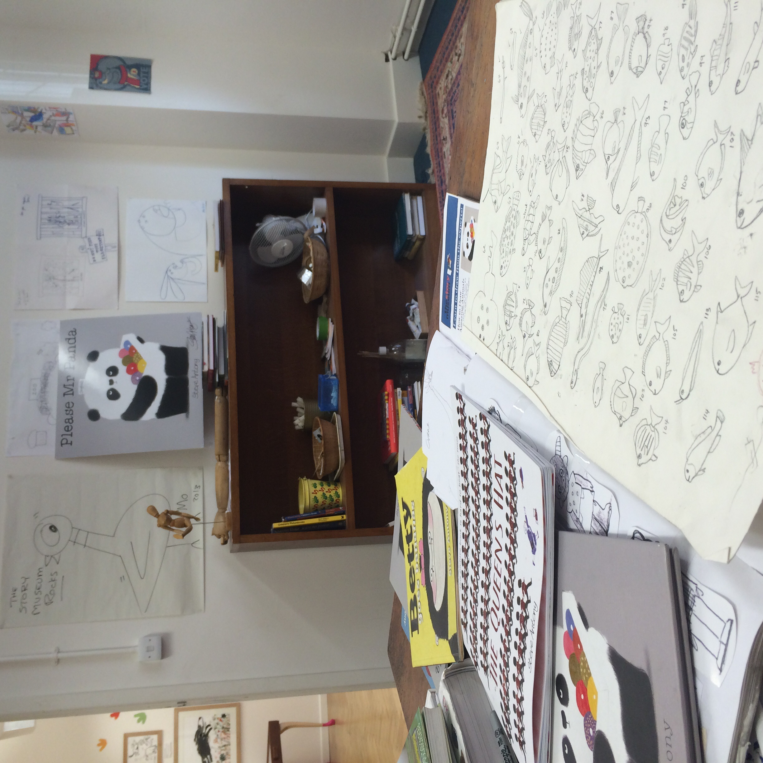 After my exploration, it was time to settle into my studio for the day. Here, my sketchbook is opened on a page of fish drawings. In the studio,I was surrounded by amazing art by the likes of Mo Willems...