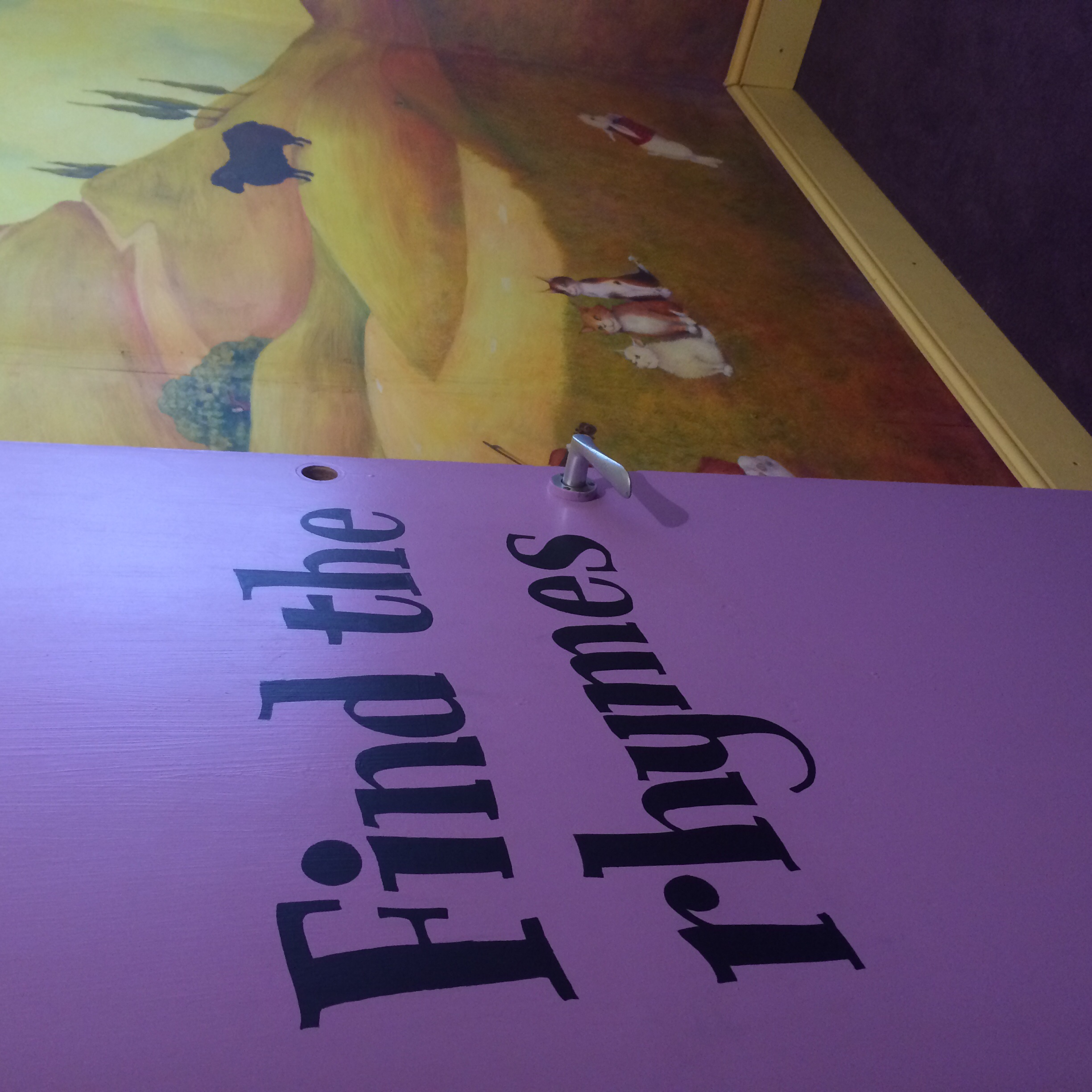 I entered the rhyming room. On the walls were beautifully painted murals,by...