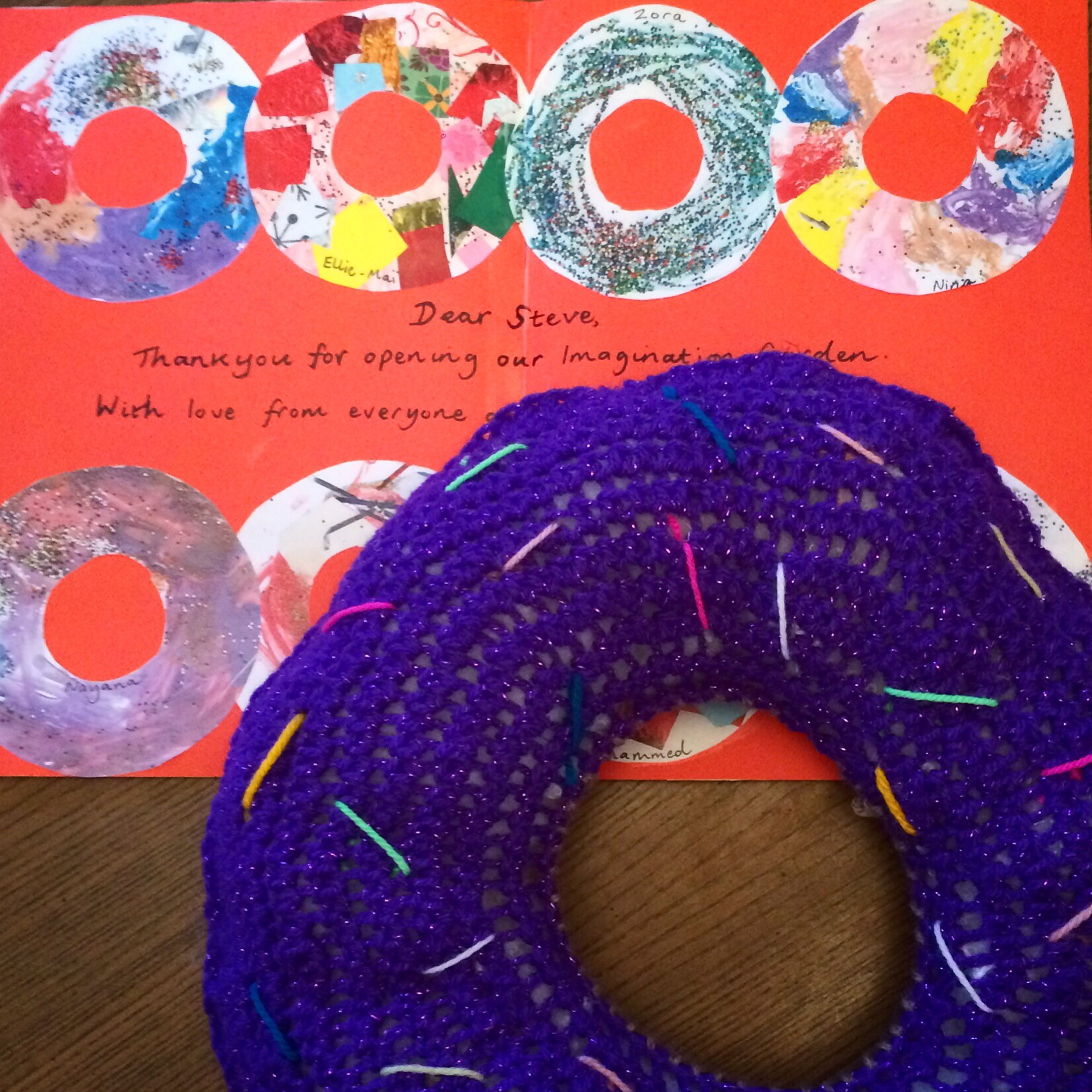 A colourful doughnut card and a giant doughnut: a thank you gift from the school!