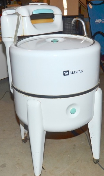 A wringer-style washing machine, not exactly like the one had but similar.
