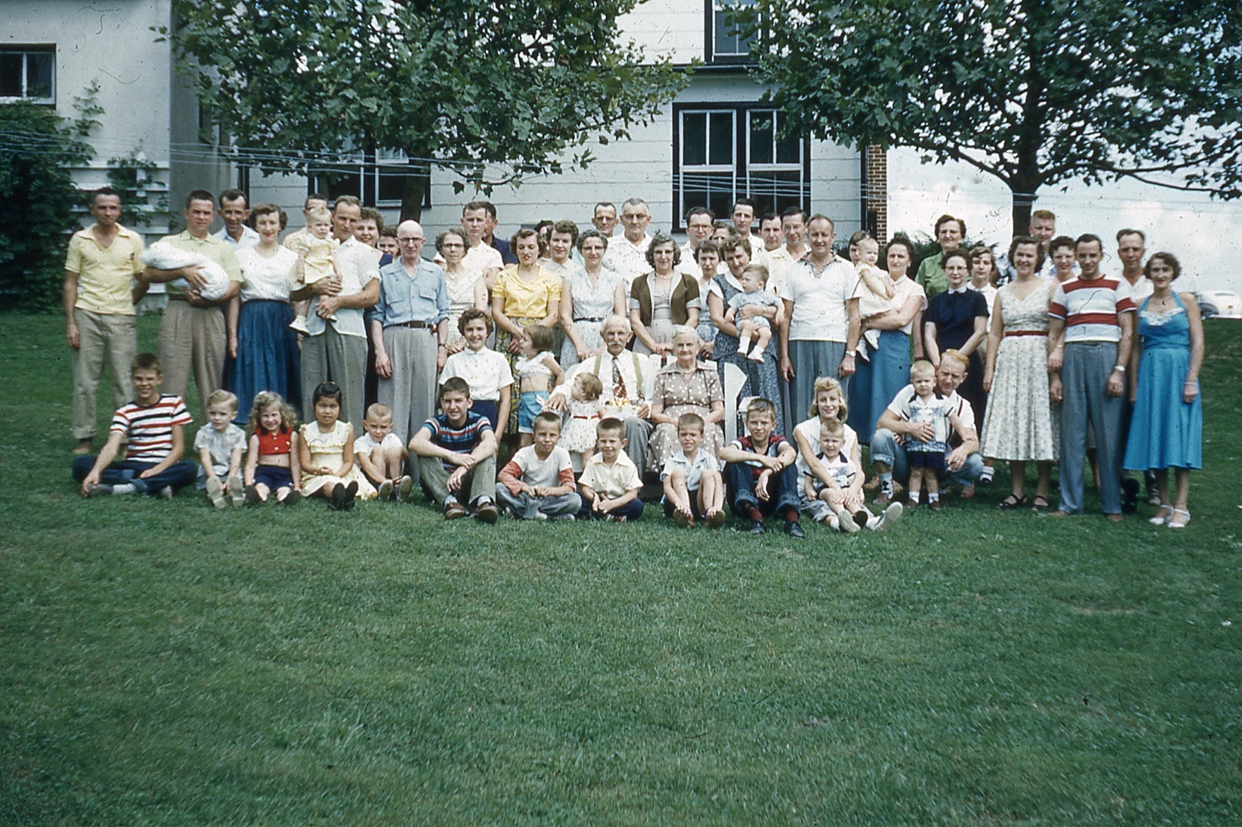 This photo of the entire Zeller(s) clan (one of three taken that day, but it's the most complete) was most likely taken on Labor Day weekend in 1955. I think my uncle Allen (far left in yellow shirt) took it with a time delay, which is why he looks blurry. Next to him are my uncle and aunt Mark and Joan; he's holding their son Randy who had been born a month earlier, and my father Arthur is directly behind them. Next to them is great uncle Eddie (Edwin) holding my sister Donna with his wife Clara peeking over his shoulder, and then come my grandparents, Harry and Tillie (my mother's head is just visible between Clara and Harry). I don't know the next two people, but peeking between them is my aunt Jane (married to Allen). Sitting in the kiddie row third from the left is Barbara (daughter of Ray and Arlene Light (Arlene's in the dark dress fourth from the right; Ray's just a head at the right hand window)). Next in the kiddie row is my cousin Kathy, then me in short pants. Don't know the next guy, but next to him is my uncle Reed. Of course, those are my great-grandparents sitting right behind the kids, and that tall kid in the white blouse directly in front of Tillie is Helen Fortna, whom we finally figured out is Donna and my second cousin. Her parents are Betts and Barney Fortna (and I'm stopping after this); Barney is second row far right and Betts is wearing a green blouse standing behind Arlene Light, I think. Oh, and Elmer (next to last son of Grant and Emma) is the guy in the horizontal striped shirt second from the right. [Deep exhale]  Oh, yeah, Kathy's mother Fumiko is completely hidden (that's the danger of a time lapse photo) and her father Neal's head is mostly obscured by my sister Donna (being held by Eddie).  (Click on the pic to enlarge and hover the mouse pointer over the pic to see this caption; move the pointer away to remove the caption)