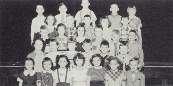 Patricia is the third from the left in the front row