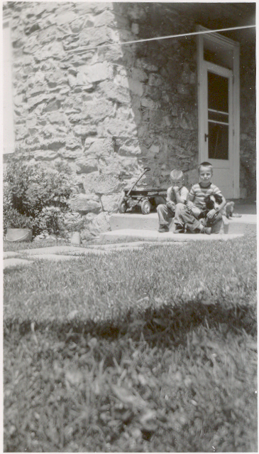 This is me and Reed sitting on the back porch of the Great Stone House in an undated photo that I'm guessing might be from 1955 when I was six. I don't recognize the dog.