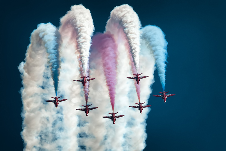 Seven of the Red Arrows at the top of a loop during their display at RAF Cosford air show 2013.