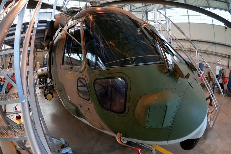 An EH-101 undergoing basic maintenance in the 751 hangar.