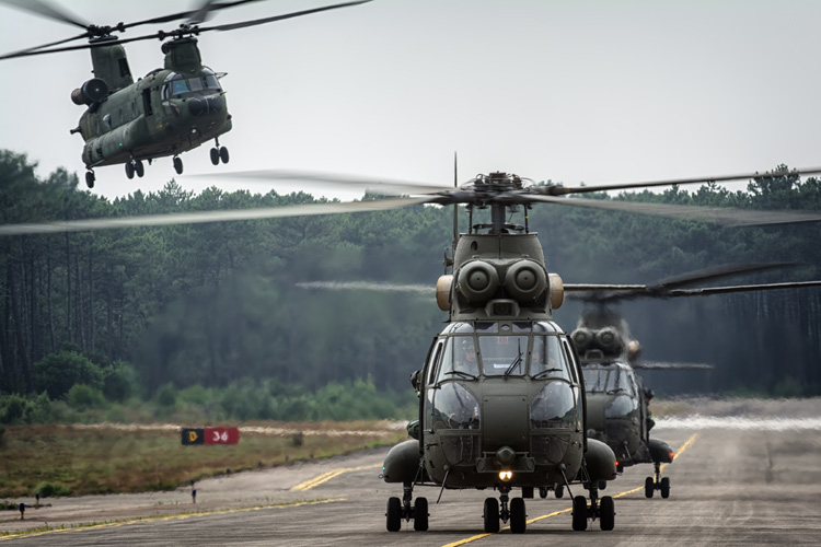Two 230 Squadron RAF Puma HC2s and a RNLAF CH-47D Chinook recovering back at Ovar.