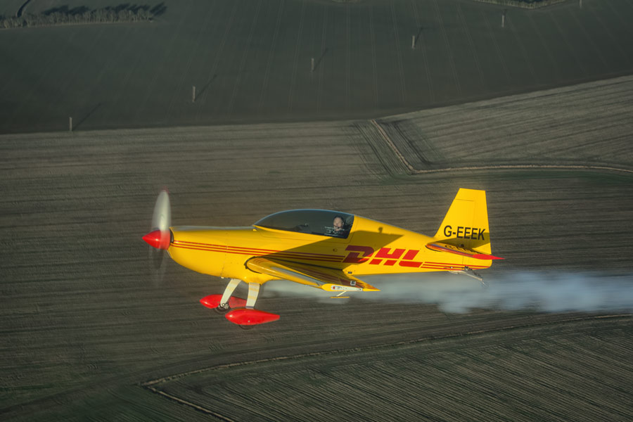 The British Aerobatic Academies extra EA-200 wearing a DHL livery.