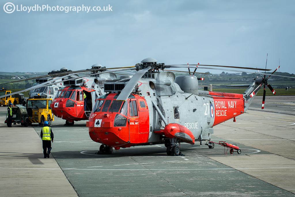 Two 771 NAS Sea King Mk5s on the dispersal at RNAS Culdrose and a 'bagger' ASaC Mk7 Sea King.
