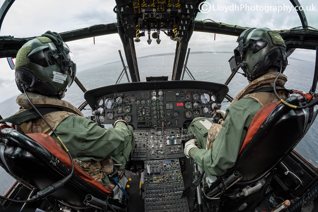 The cockpit of a 771 NAS Sea King Mk5, no MFDs to be found here! The RH pilot in command is practicing IF (instrument flying) and simulating bad weather conditions.