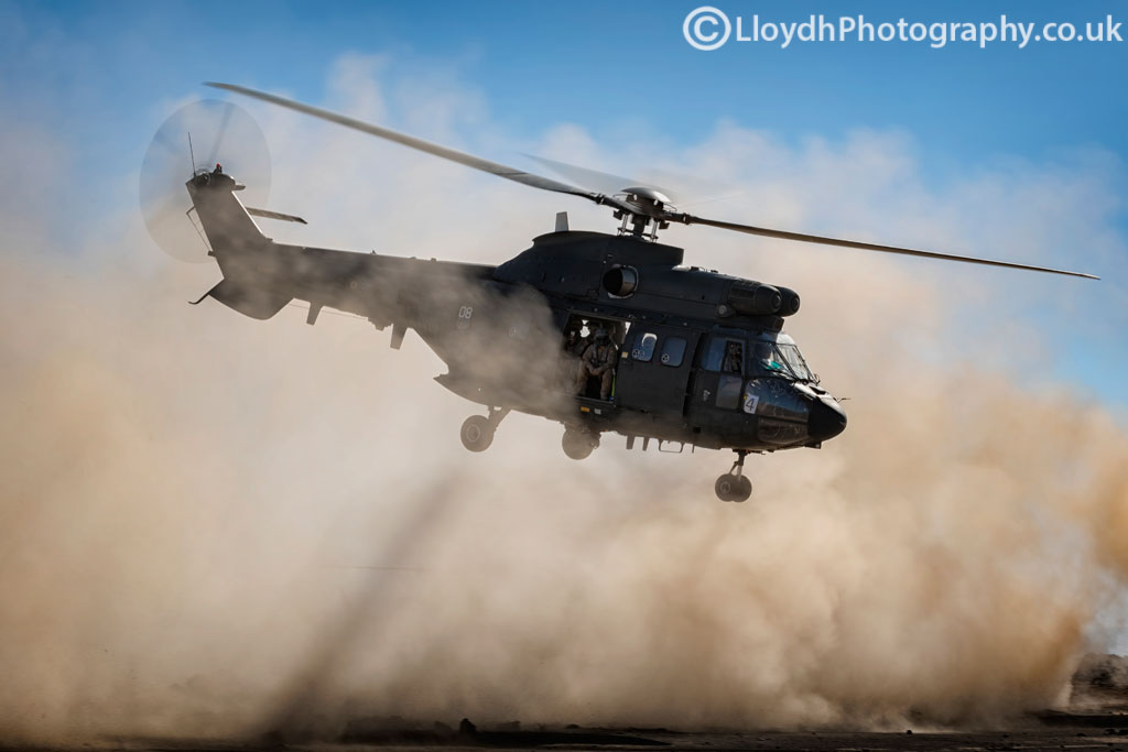 The kind of environment the D500 had to put up with, dust everywhere as this AS332B Super Puma gets airborne with a full load out of troops.