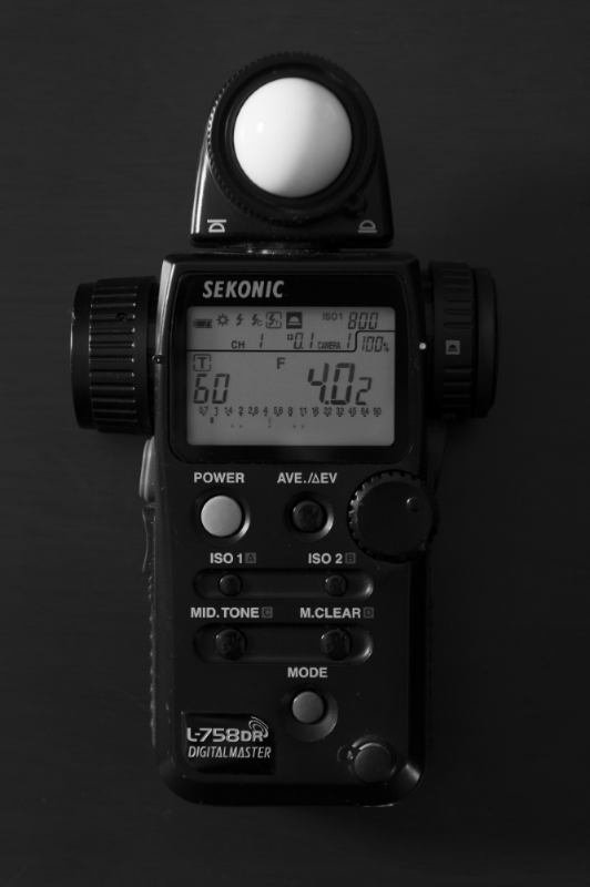 Sekonic light meter featuring incident and spot metering capabilities for flash and/or continuous light.