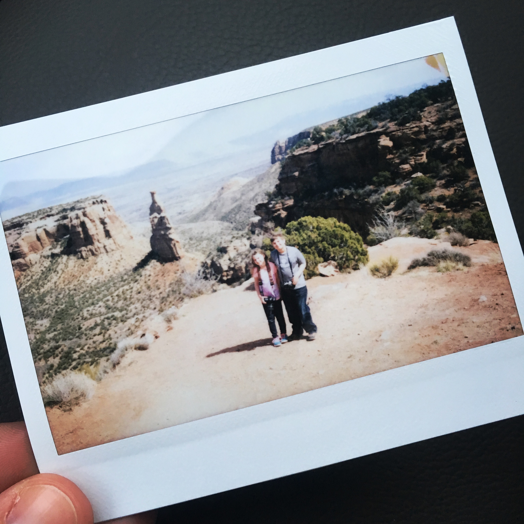 Instax of Michael and Celia at the Colorado Monument.