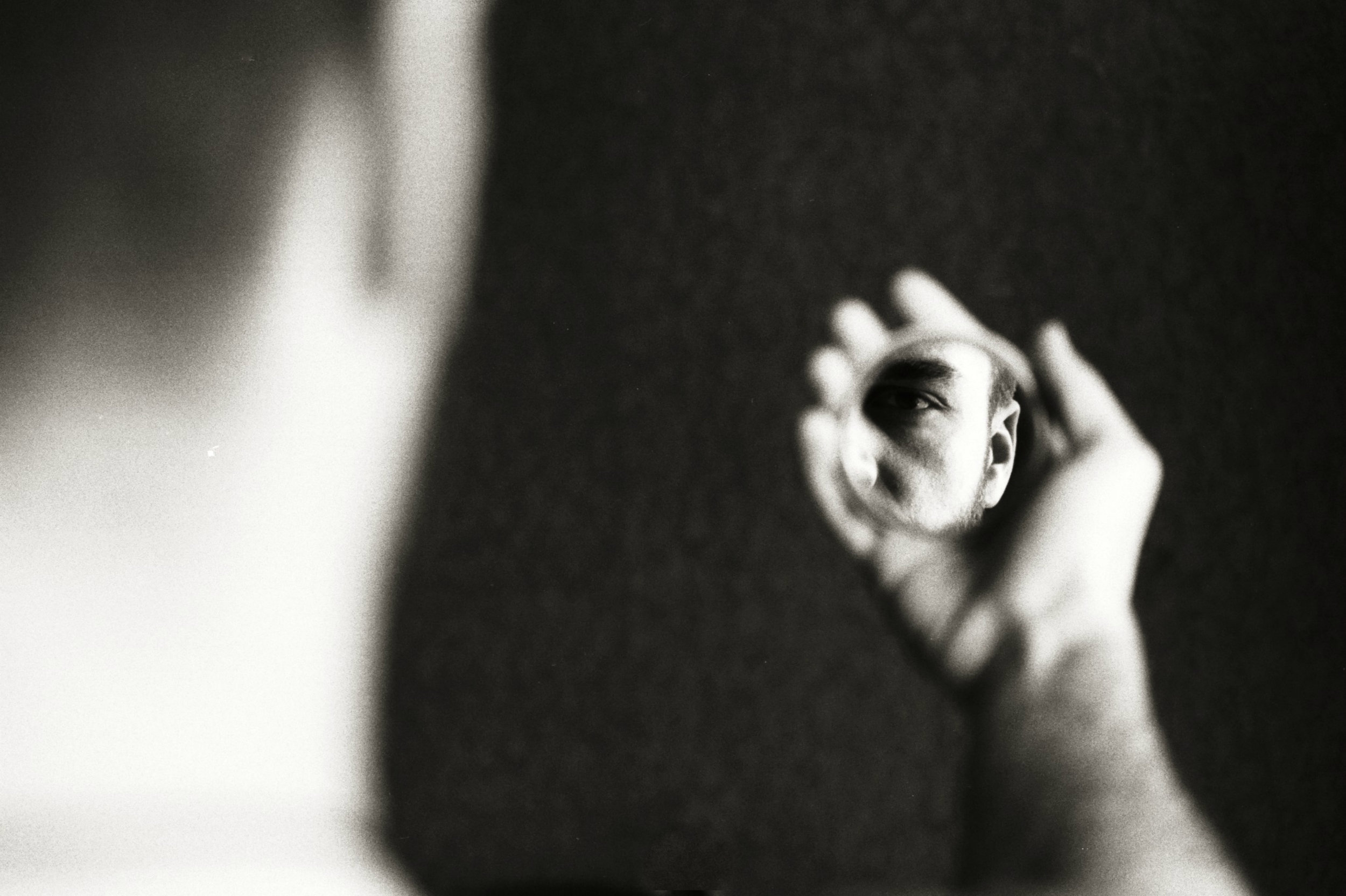 Zurab Chachanidze | Face in little mirror | Nikon F90 | Kodak T-Max 100