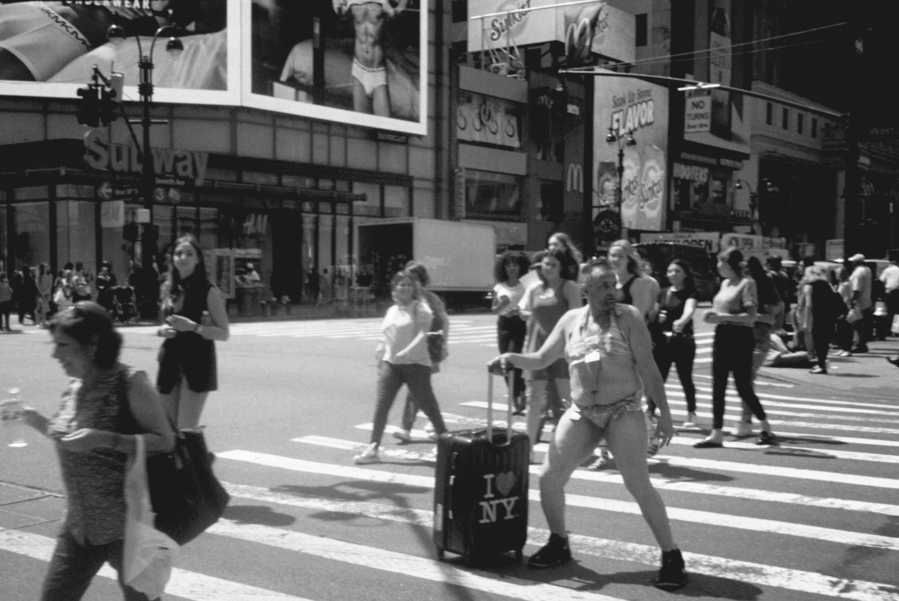 A Moment in the Streets. Midtown Manhattan. Photographed on 135 (35mm) film. Konica C35