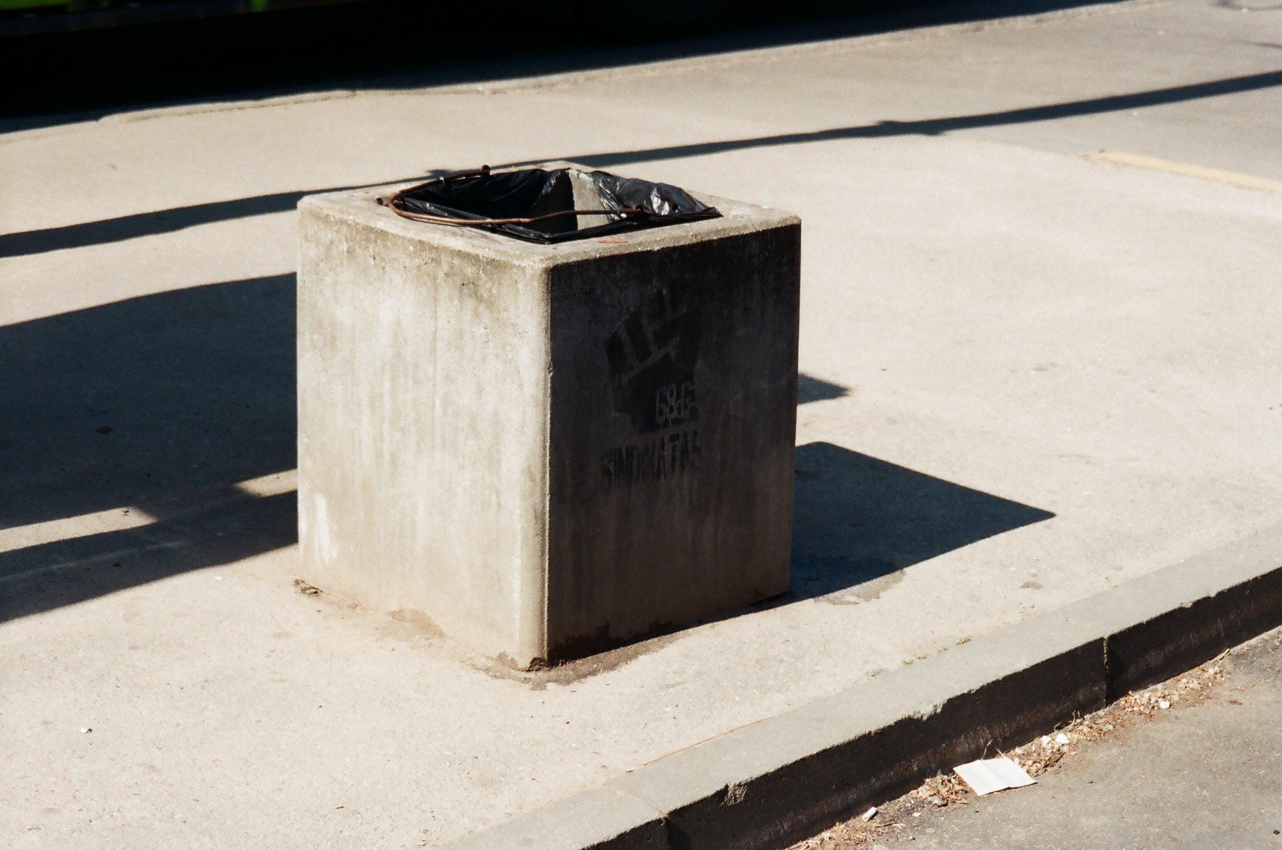 Market aesthetics (trash bin next to the bus stop ).