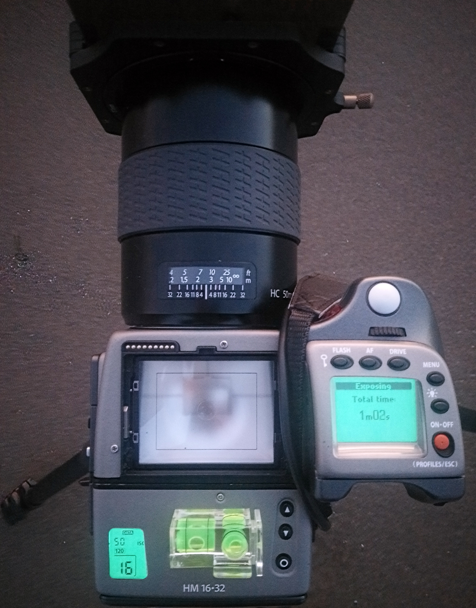 The H1 without prism during an expsoure with the main LCD illuminated showing the time elapsed. The film back LCD illuminates as well.