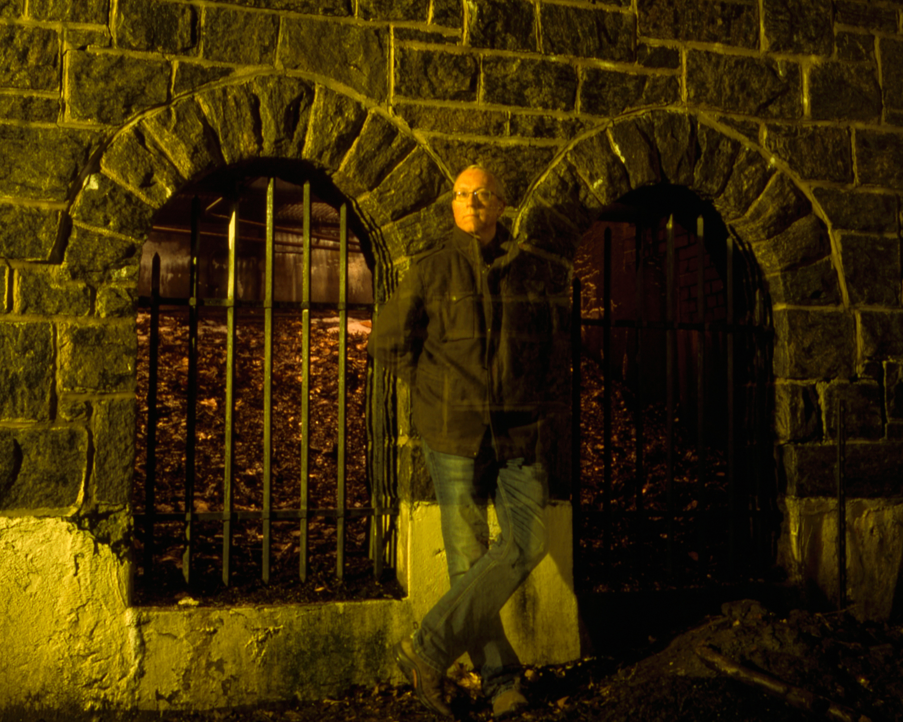 Colin Poellot  Shot March 9, 2019 at night in Riverside Park, New York, NY with a Rolleiflex Automat on Fuji Provia 100 film. Bulb time 60s exposure.  The last few years of my life have seen tremendous change, both good and bad. I've lost a few good friends to addiction and disease, moved 3 times, strengthened some relationships and severed others, adopted a rescue dog, and traveled to some new places. I'm constantly reminded of how transitory life is, so my favorite style of self portrait somewhat reflects that. Stepping in and out of the frame of a long exposure to create an impression, but not a strong one, shows how we fade in and out of our environments.This shot is in front of a stone enclosure that houses lighting to illuminate Riverside Church at night. I walk by it every day with my dog and it took me a month to figure out what it was for!