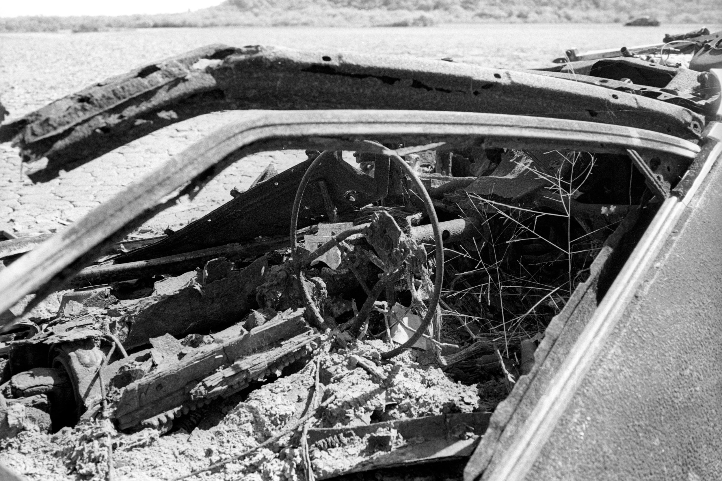 Last time I was here, this car was still standing, and the seats were still holding up. I came back after 4 years and this is what's left. Kodak XX-5222 , Leica M6 w/ 35mm f/2.5 (Elijah Clarke).