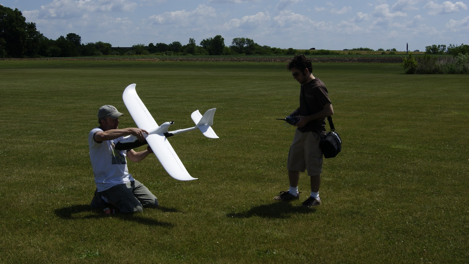 Selen and myself (right) Testing radio equipment before flight in Tuscola.