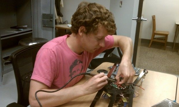 Ben Kriemer, a University of Nebraska - Lincoln journalism student involved with the Drone Journalism Lab, works on a multirotor drone. Photo by the   Journal Star.