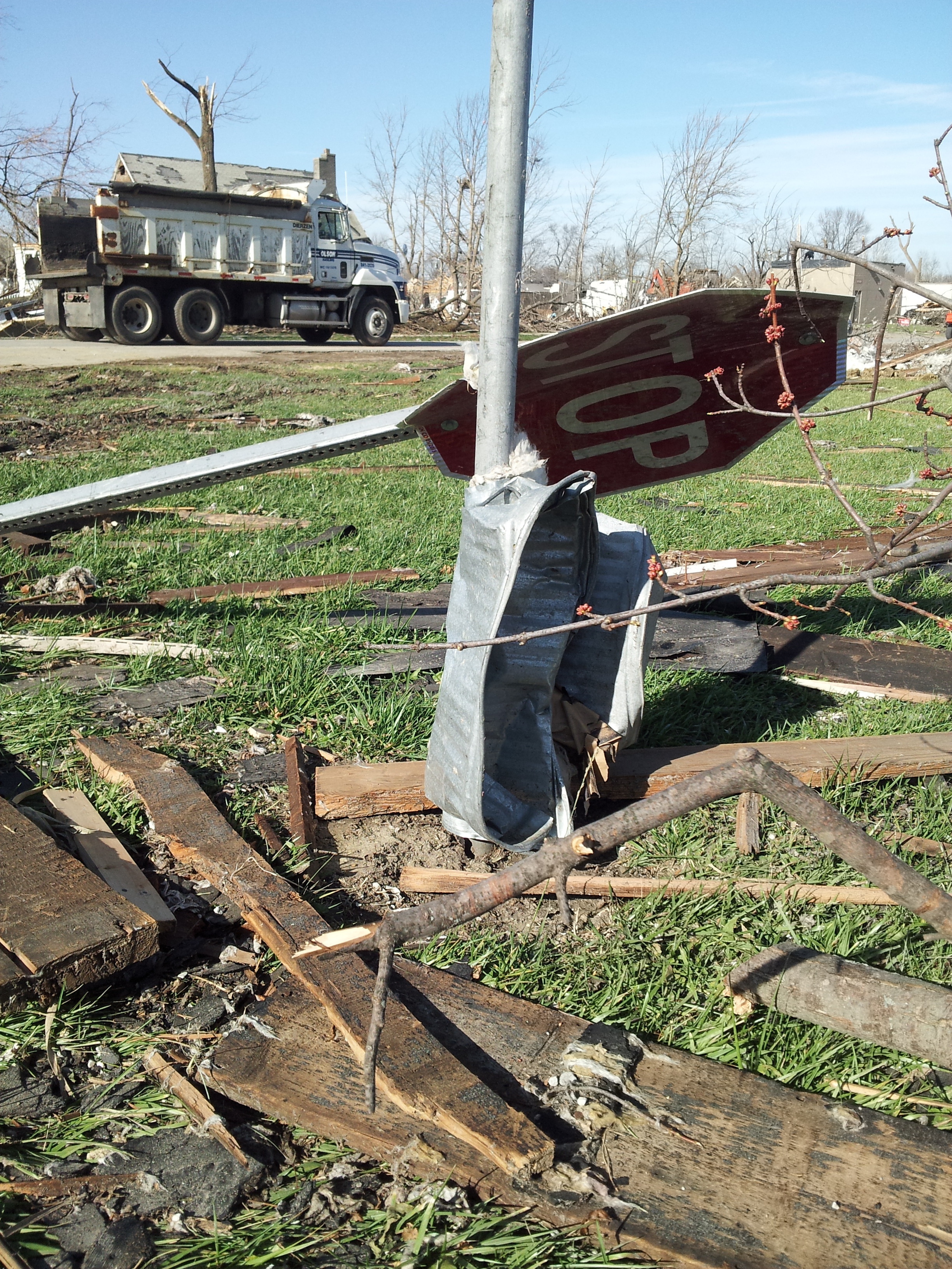 Strong winds from the EF-3 tornado crushed andwrapped this trash can around a pole.