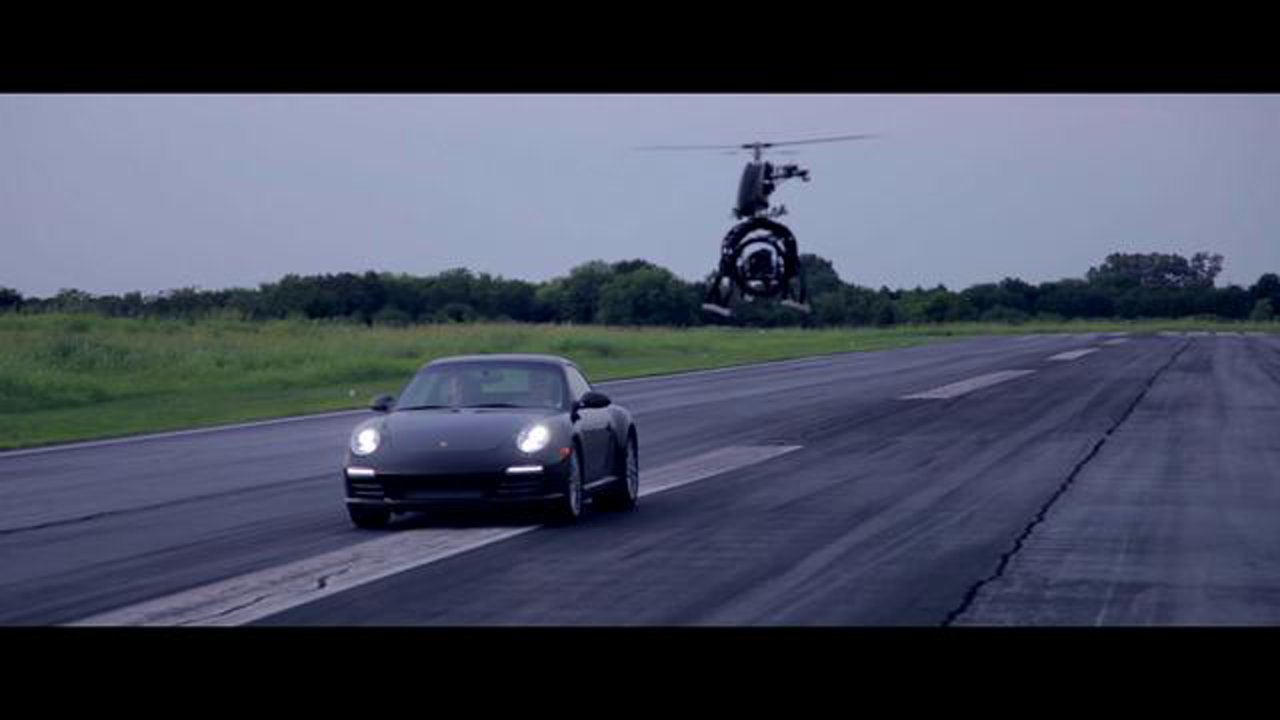 A Snaproll Media unmanned helicopter, chasing a Porsche 911 as part of a promotional video.