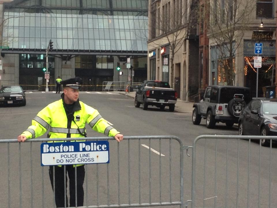 The officer who had informed me of the horrifying news: I had been standing just a couple feet from a bomb on Marathon Monday. The spot is at the corner just over the officer's shoulder.