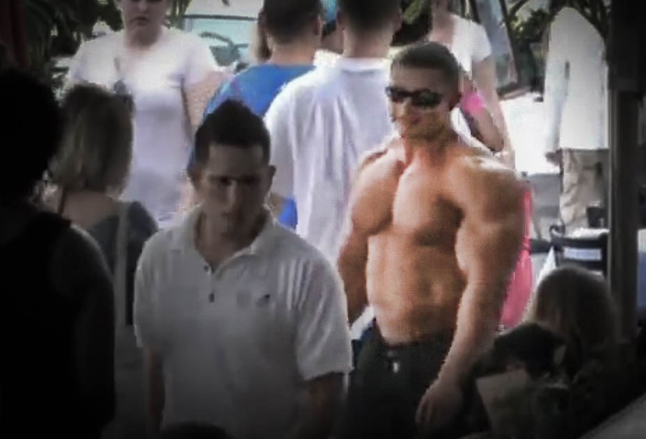 Oh, you know; just your average freakishly large muscle dude casually showing off some pecs in a crowded street.