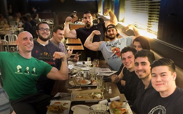 Clowns in the back. What would a farewell dinner for @ali.rohann without a little bit of conspicuous #biceps mayhem? The #bodybuilding community of #Boston, the #NortheasternUniversity #MarinoCenter #lifting community, and most certainly all of us at @thenextlevel_teams will dearly miss having this legendary local #bodybuilder in our city. But we are excited to wish him well in his new career adventure! #ThePowerOfTeam #TheoryOfJoy #FindTheWhy #KnowYourReasons #offseason #drugfreebodybuilding #muscle #Ibrokemydietforthis #highprotein #LiftYourPassion #JoinYourTeam