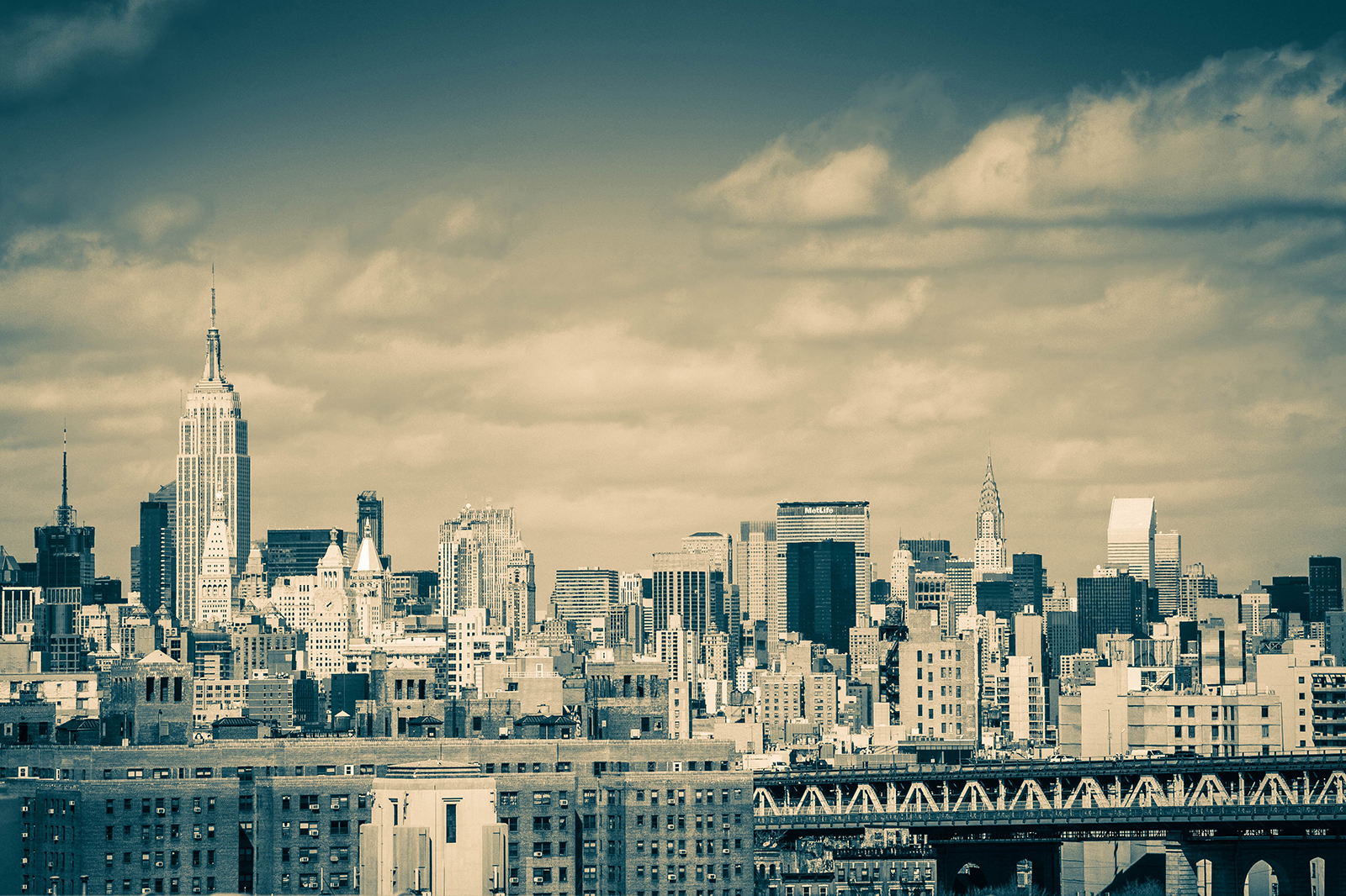 View of the Empire State and Chrysler buildings from the Brooklyn Bridge