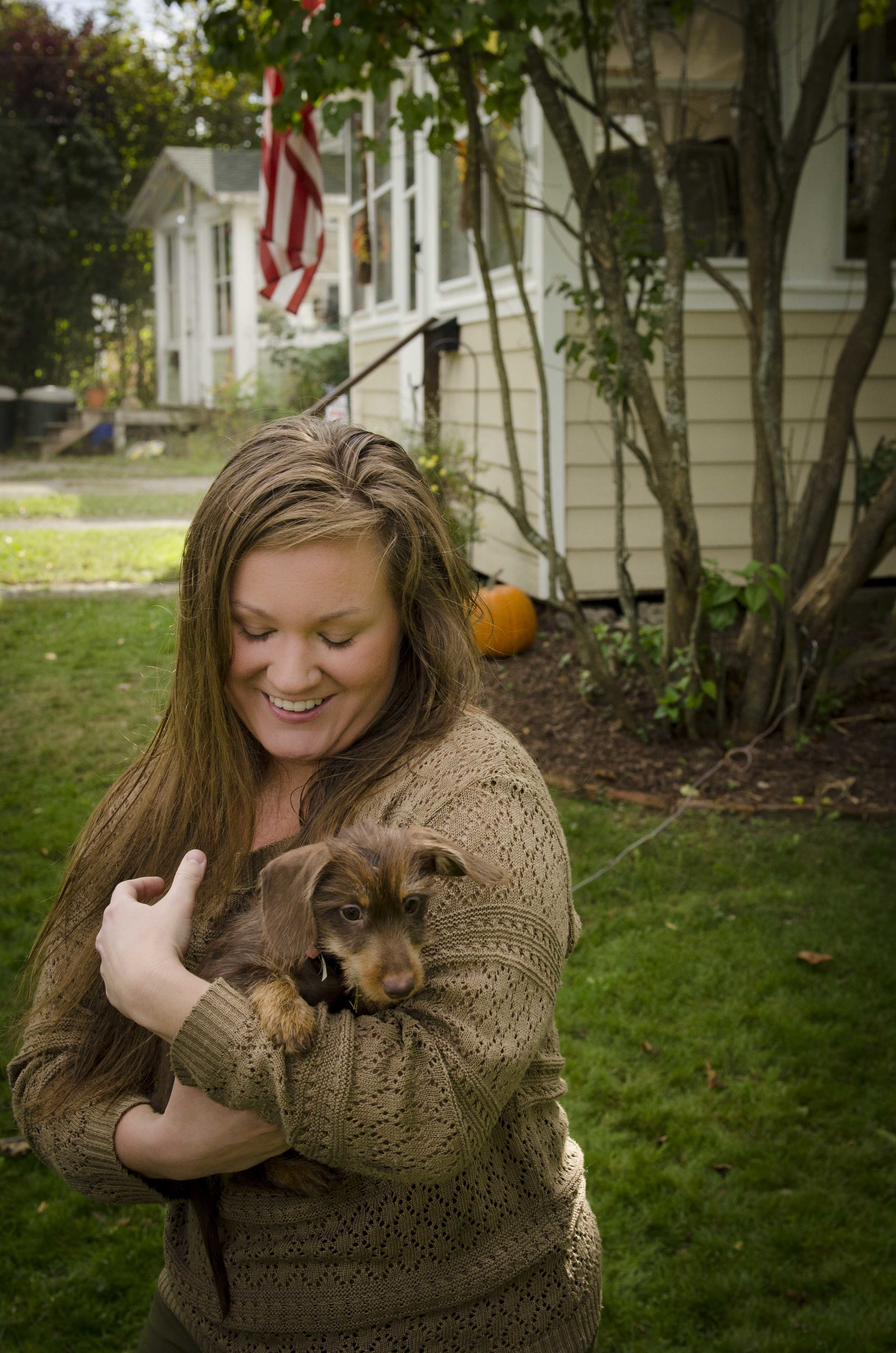 My wife holds a miniature long haired dachshund
