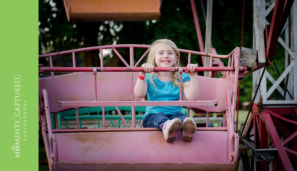 Girl riding the ferris wheel