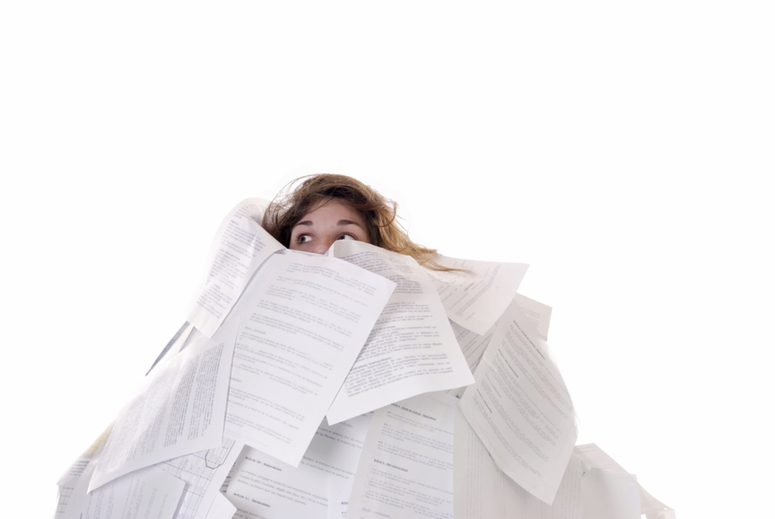 business concept:young woman drowning in papers