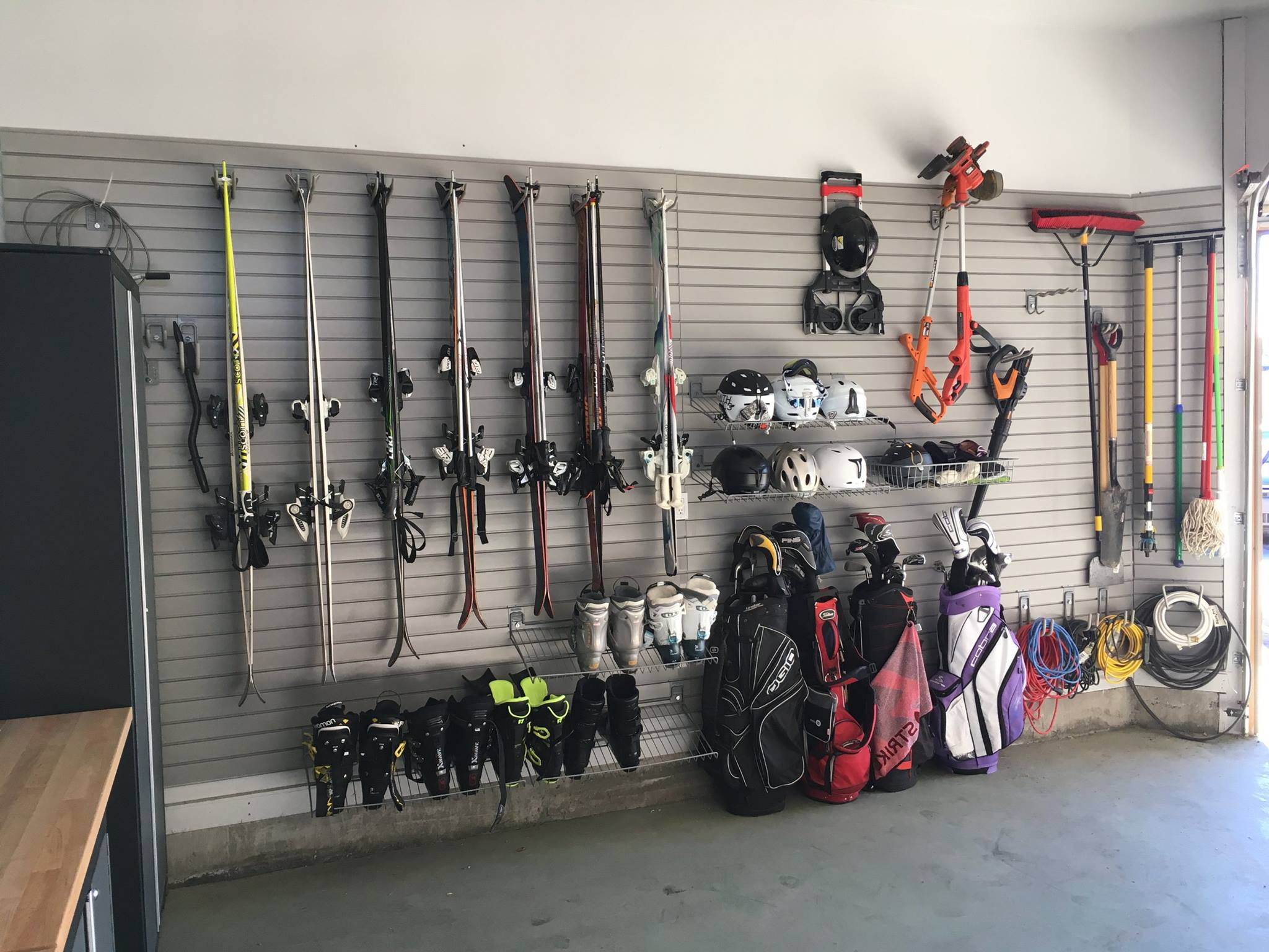 Calm Order helped a previous client organize their garage by using slat walls to store sporting equipment and hardware tools.