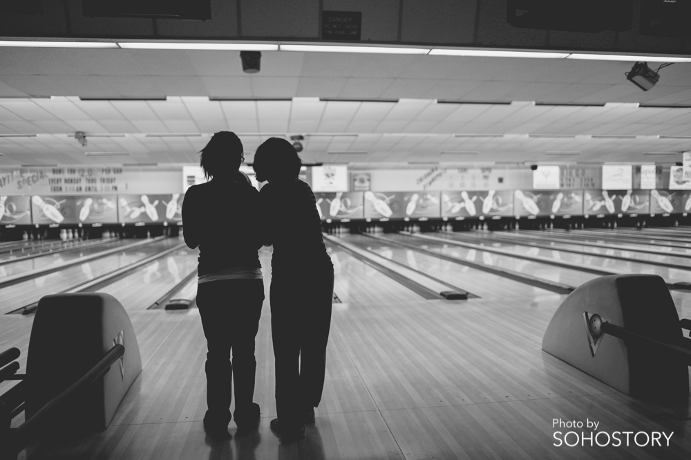 My mom teaching my wife how to bowl