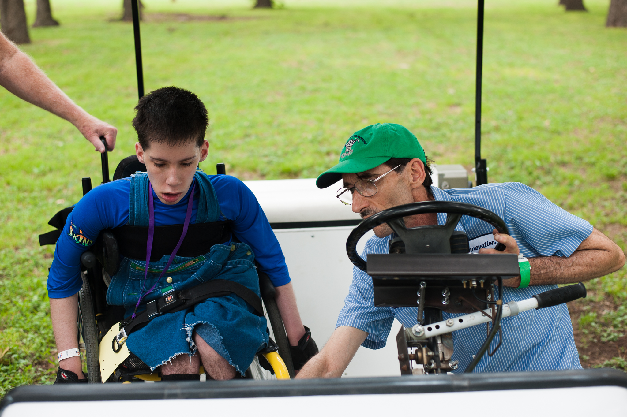 Andrew was curious about the golf cart so Harold explained all the technical parts.