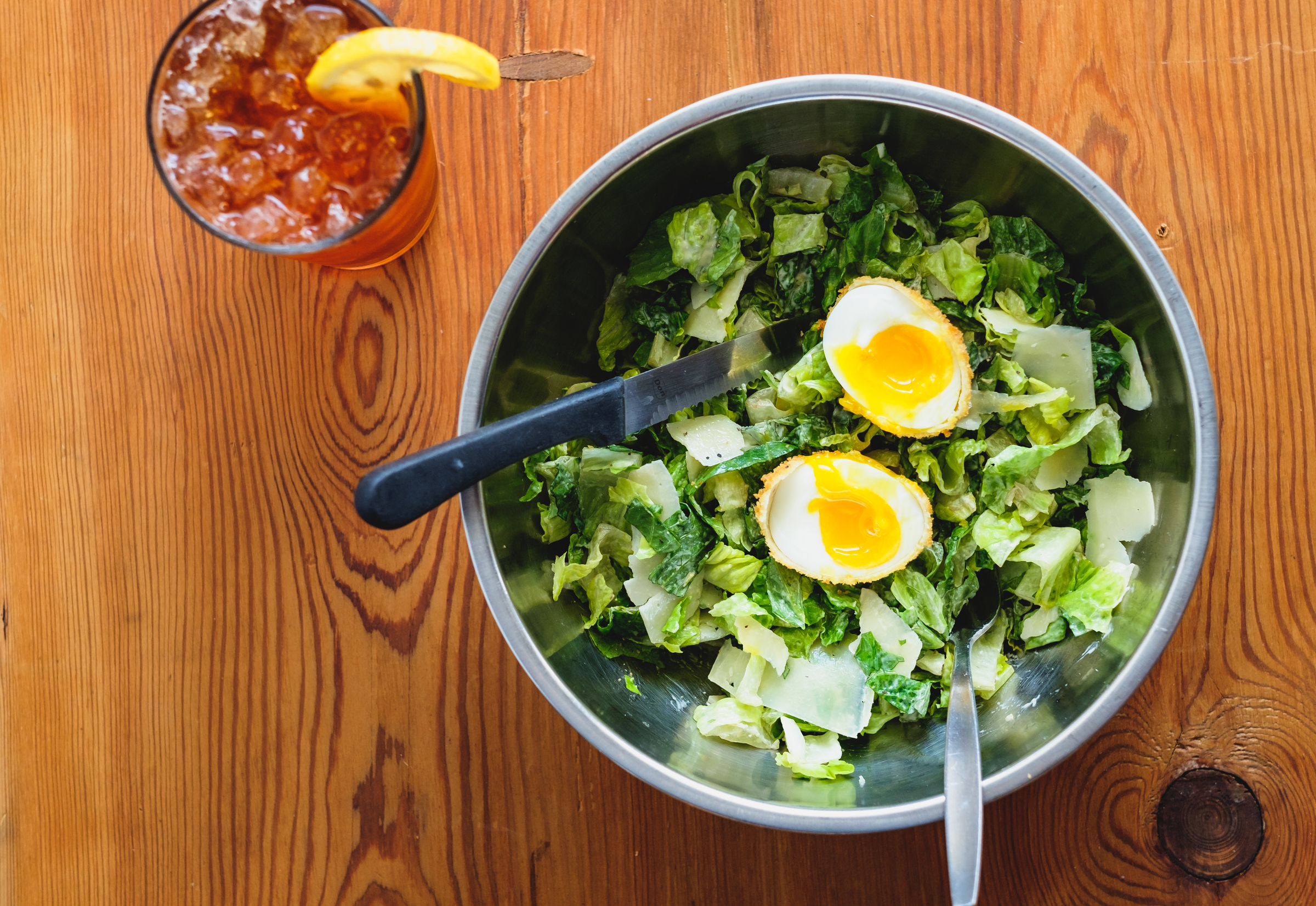 We worked fast with the Caesar salad and fried egg that still had a runny yolk. We couldn't have the yolk filming over!