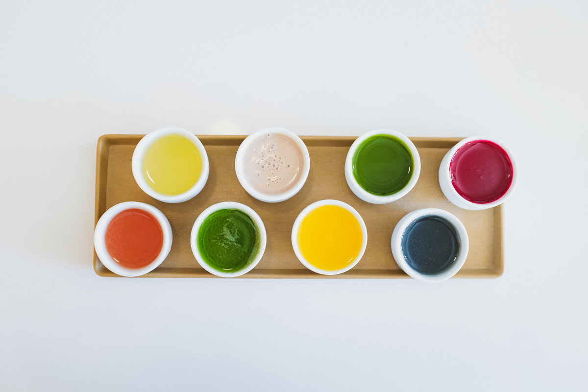 The bright colors of the juices, filled to the brim in sake glasses, look like little wells of paint.