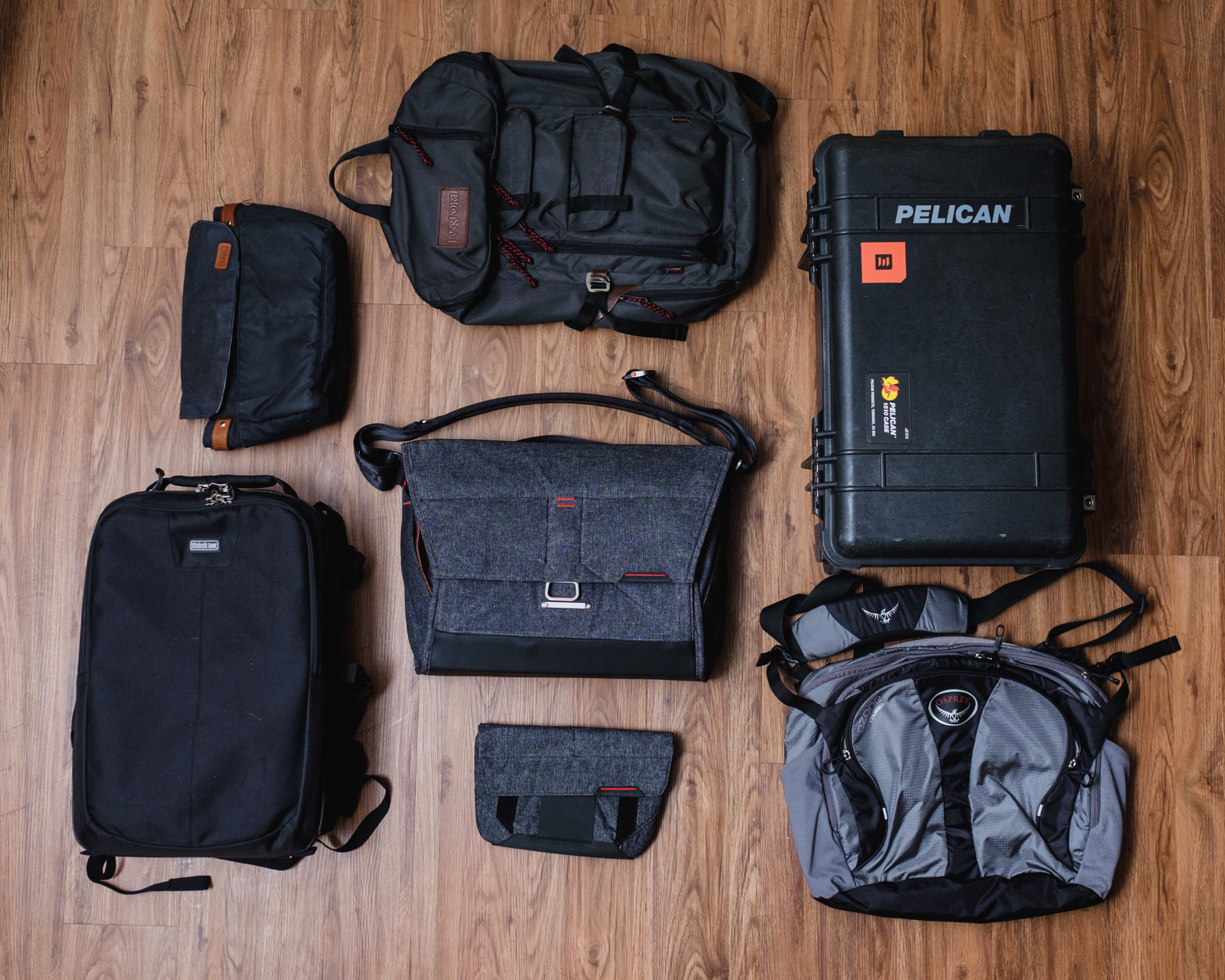 These are just a handful of the bags that I own and have used to carry my photography gear. My other bags were not included in this photo because there is not enough room to fit them all into one frame.