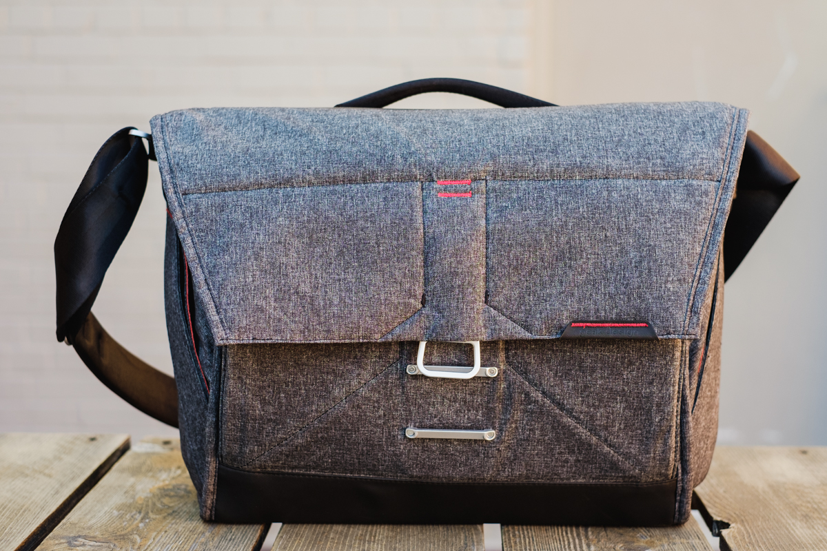 Peak Design's  Everyday Messenger Bag  - The flap is tilted because of a tall water bottle in the bag.