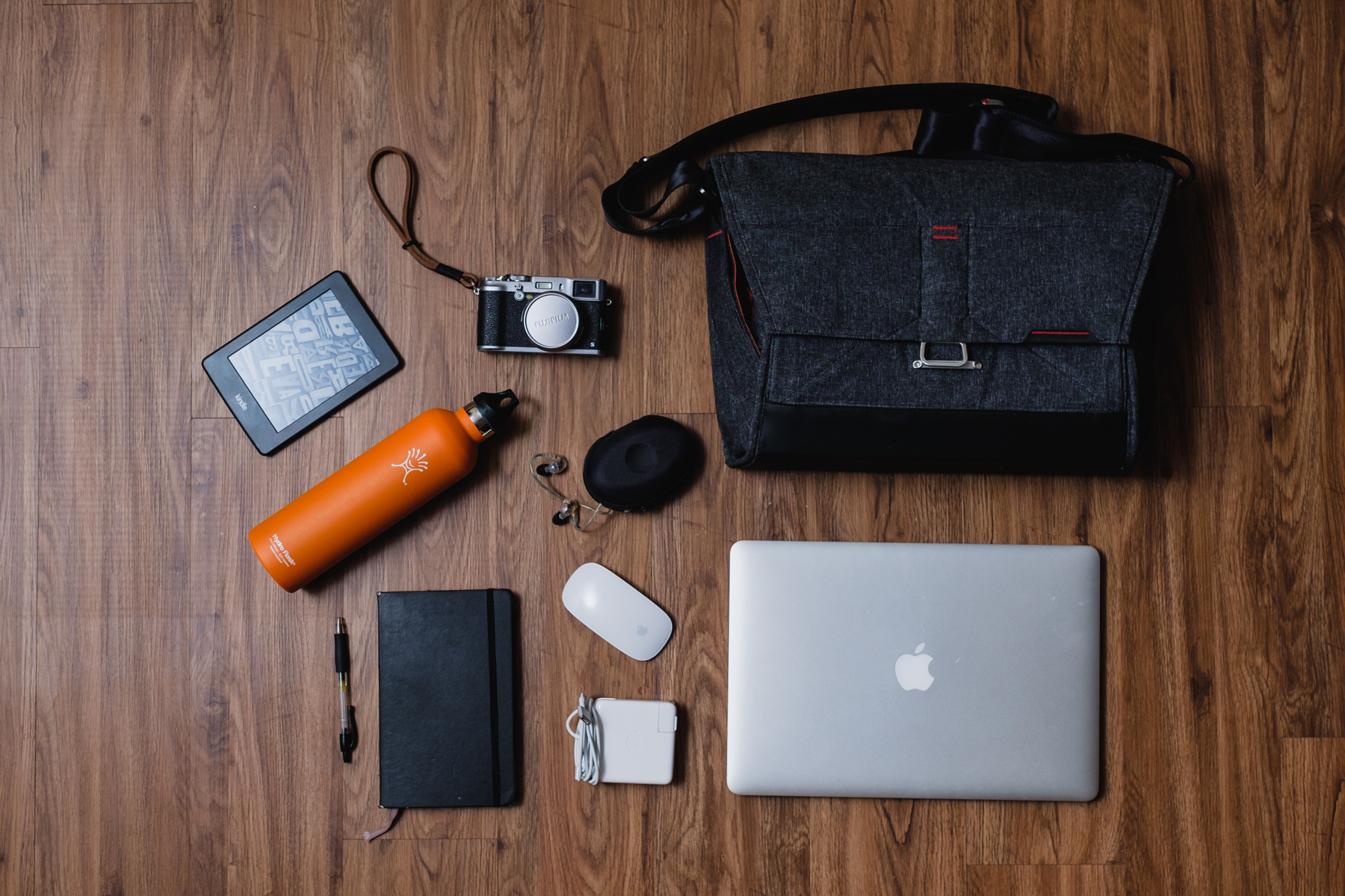 """This is my everyday setup (light version) 'Gotta get business stuff done bag'-Amazon Kindle Paperwhite, Fujifilm X100s camera ,   Shure E535 Earphones,  Hydro Flask water bottle,Moleskine notebook with Pilot G-2 Pen,  Apple Magic Mouse, Apple MagSafe Charger, and  Apple Macbook Pro 15"""""""