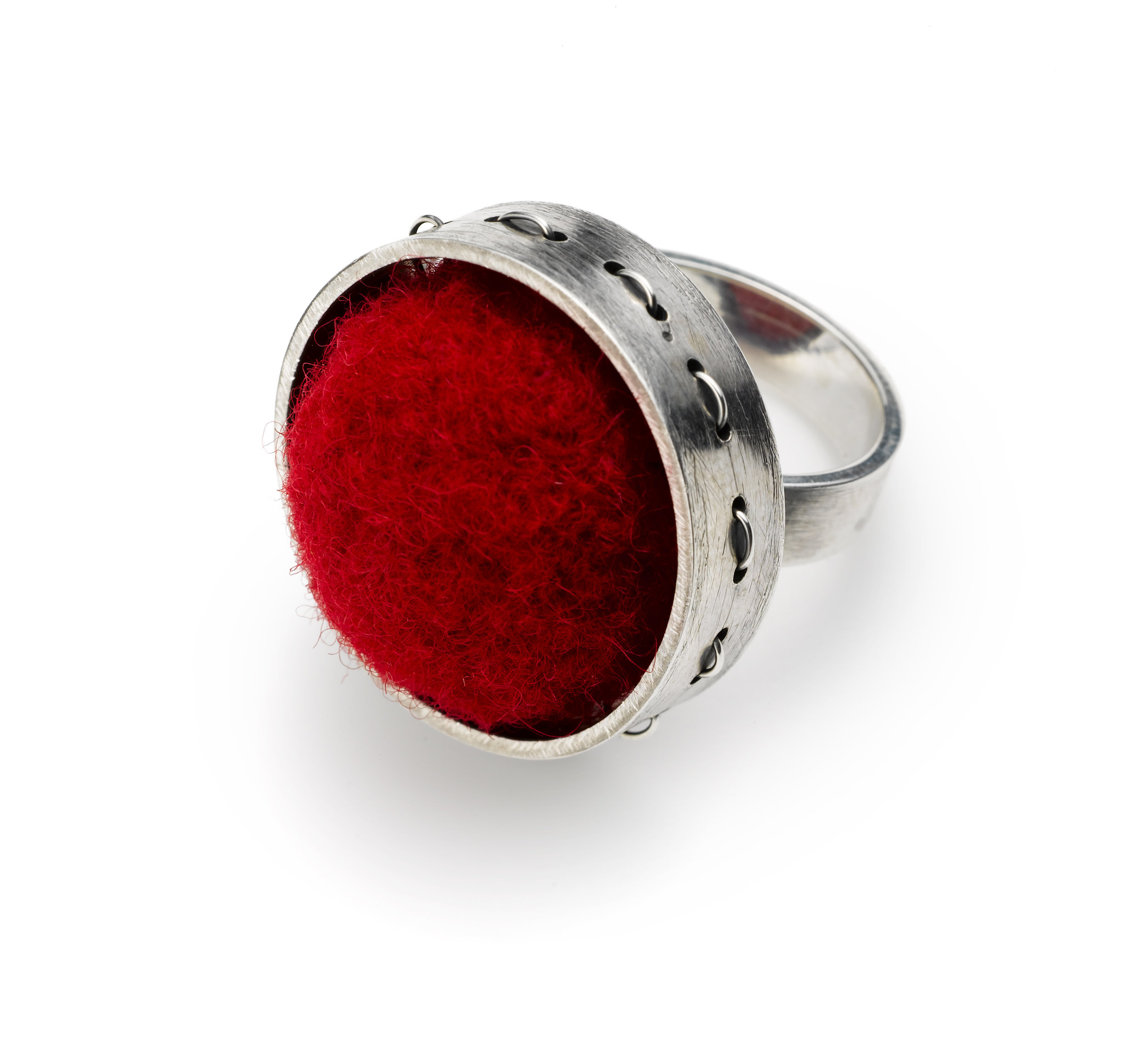 "Fabricated sterling silver ring with red wool felt 1""diameter. ""Stitches"" around the side of the sterling ring also reflect stitches in fabric and textile arts"