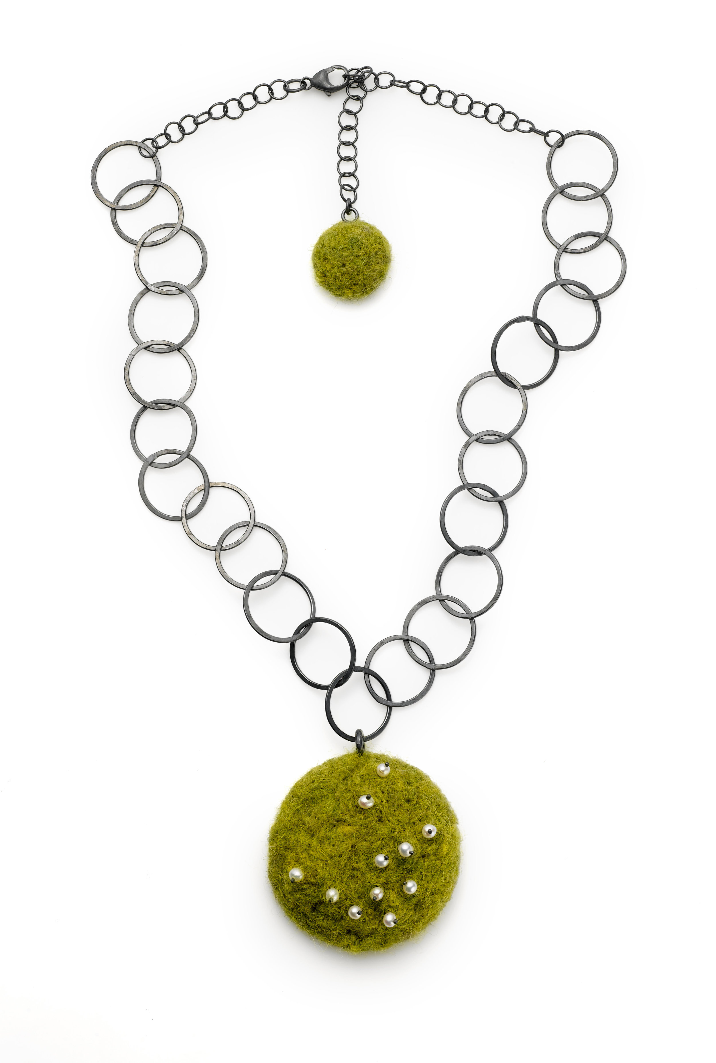 "Oxidized sterling silver hand fabricated 19"" chain with green wool felted pendant 1.5"" and pearls. The hand fabricated chain relates to the felt form which completely covers the silver skeleton that helps to define it's round shape."