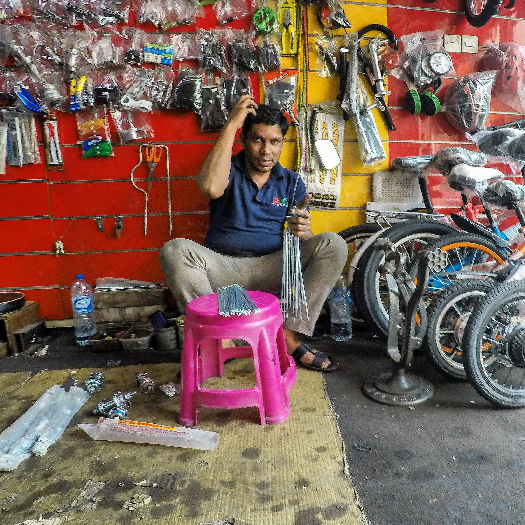 Lacing a set of wheels. Dubai, UAE
