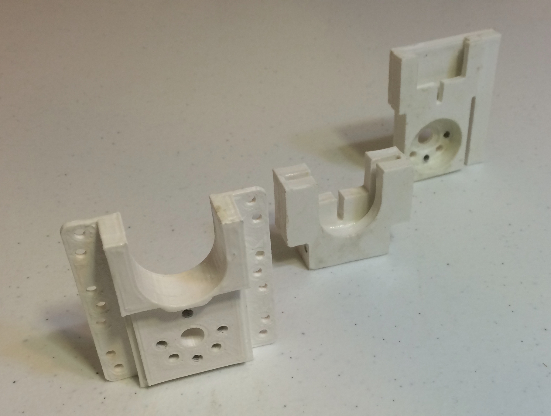 Assembled 3d Printed parts. From left to right: the front mount, mid mount, and plunger unit.