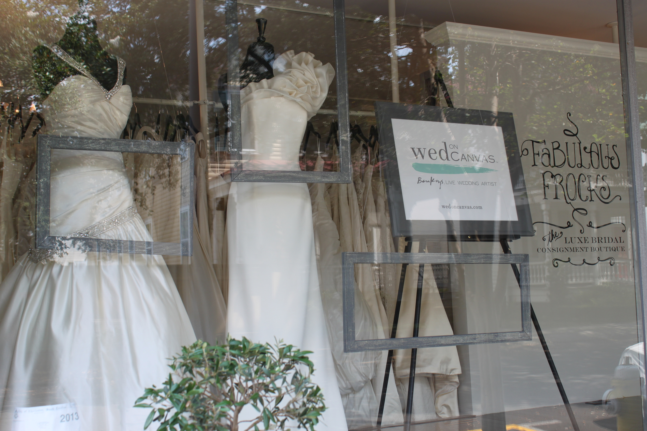 Wed on Canvas window display at Fabulous Frocks.  Ben Keys: Featured Live Wedding Artist  Photo courtesy of Jennifer Keys.