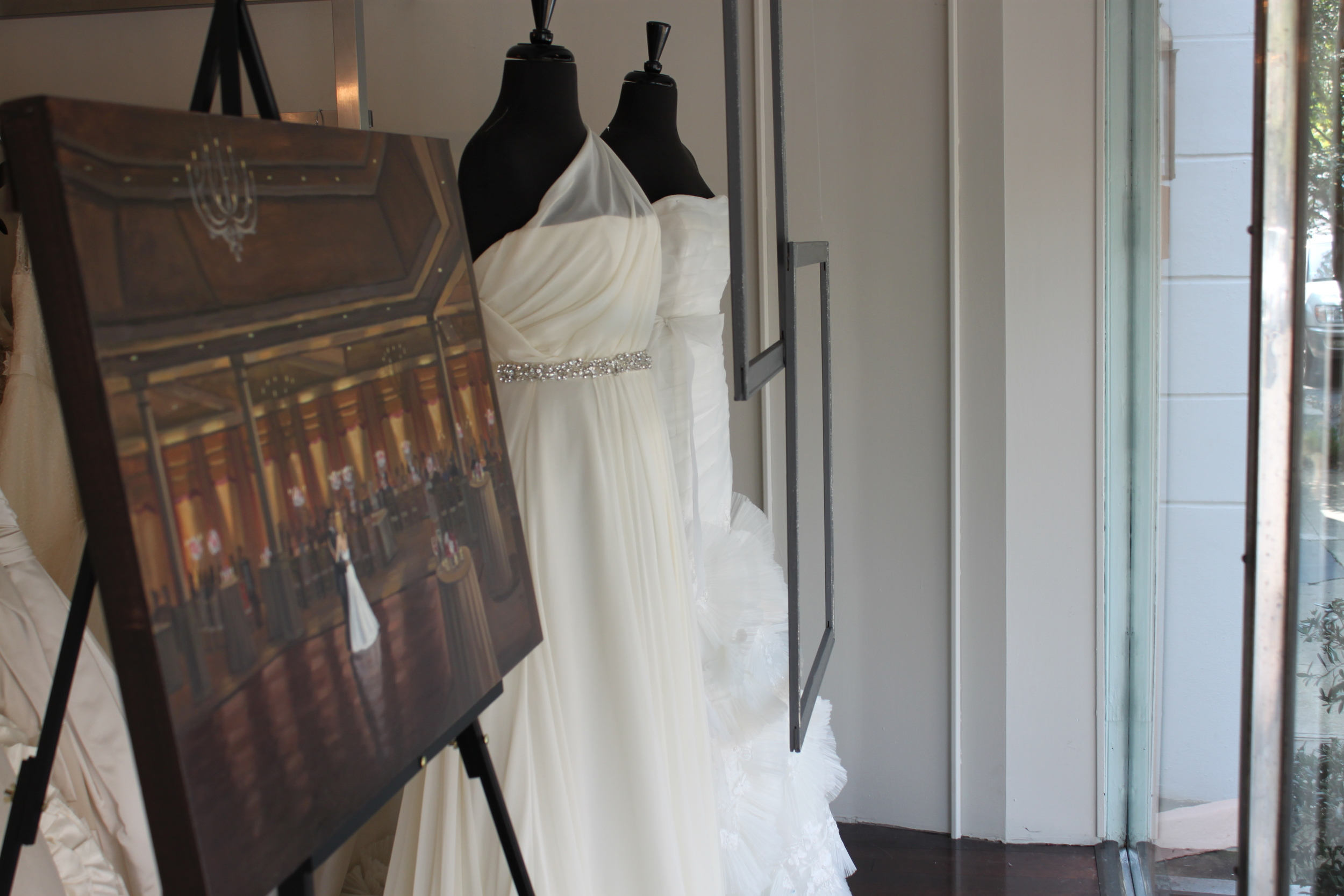 Wedding painting on display at Fabulous Frocks. Window display designed by Wed on Canvas.