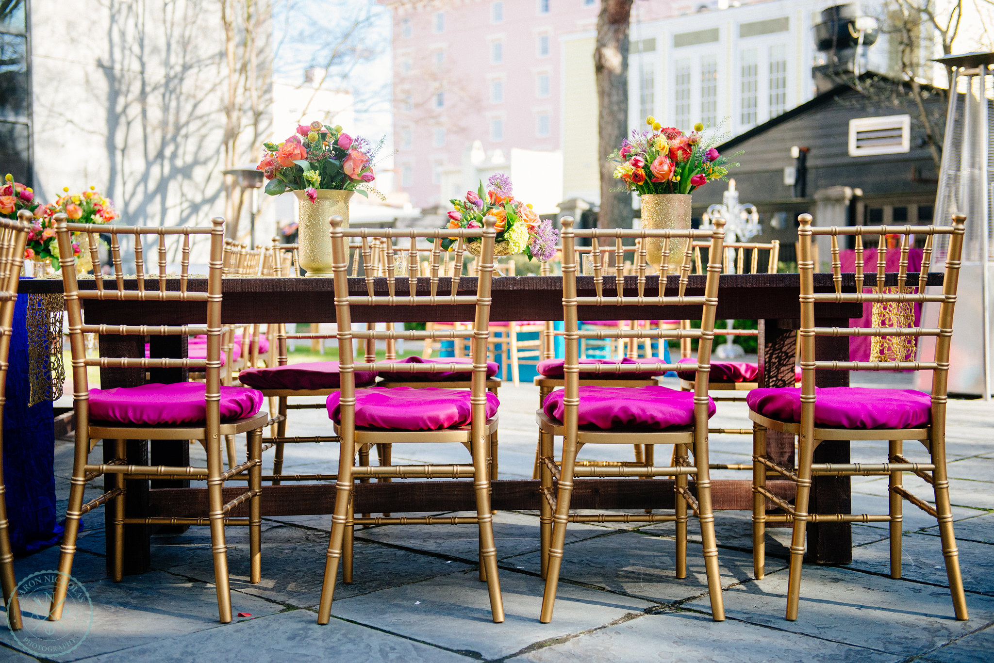 fuchsia-gold-chairs-farm-tables-glitter-gold-runner-gold-vase-pure-luxe-bride