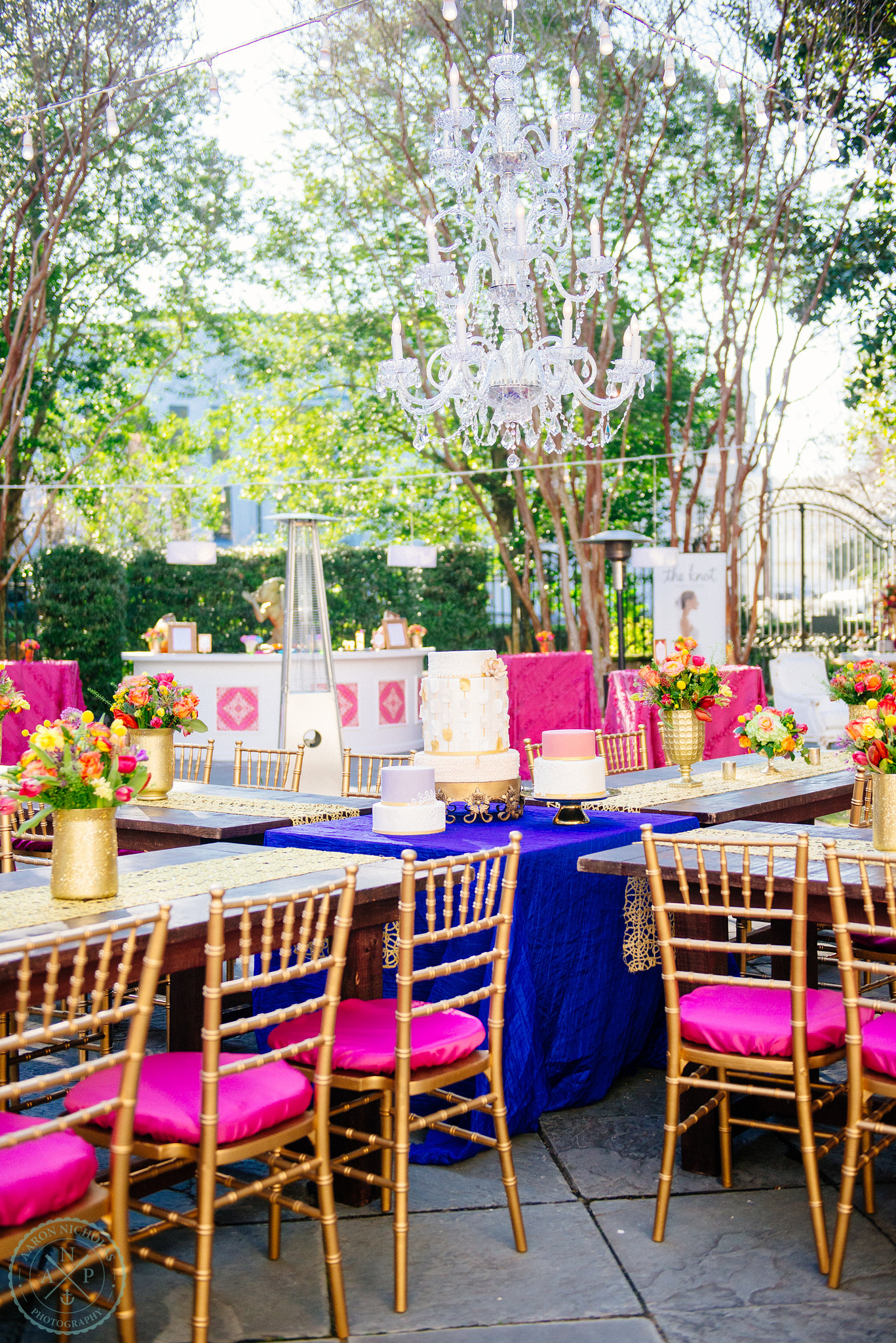 moroccan-blue-fuchsia-chandelier-garden-reception-gold-accents-pure-luxe bride